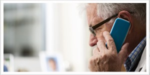 older man speaking on cell phone