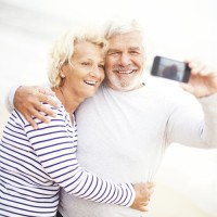 Happy older couple taking a selfie